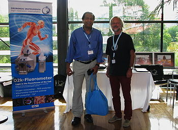 Buddha Basnyat and Erich Gnaiger at exhibition booth of OROBOROS; ISMM2014 Bolzano